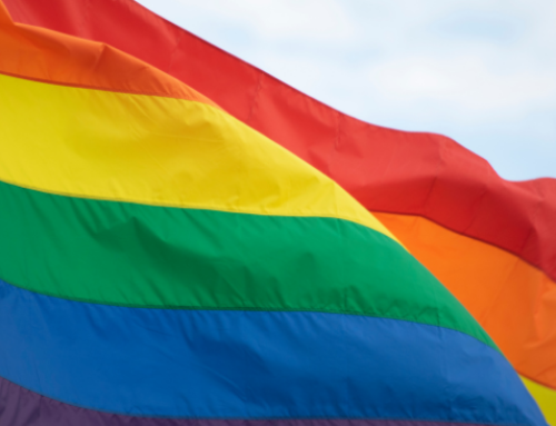 Catholic boards cave, fly pride flag